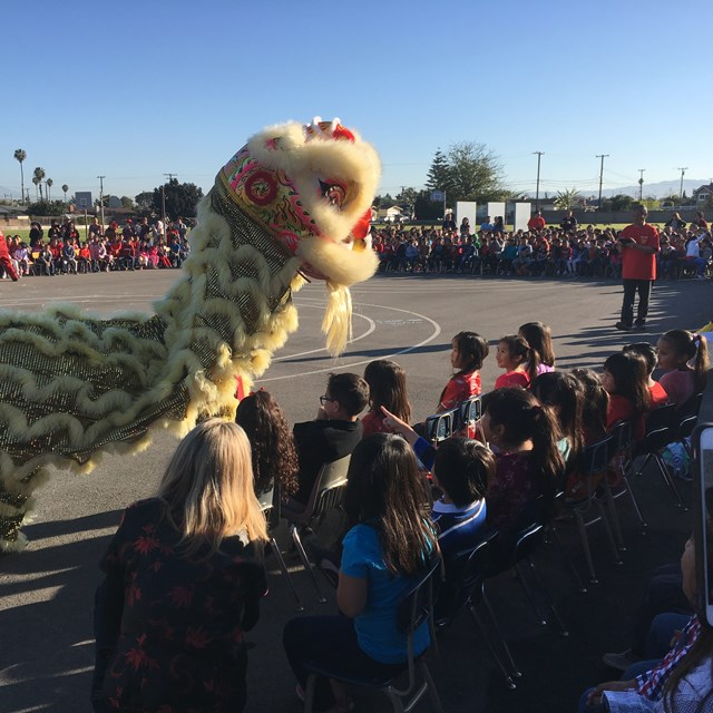 It's a beautiful day to celebrate the Tet Festival! Excited students line up to see the spectacular performance.