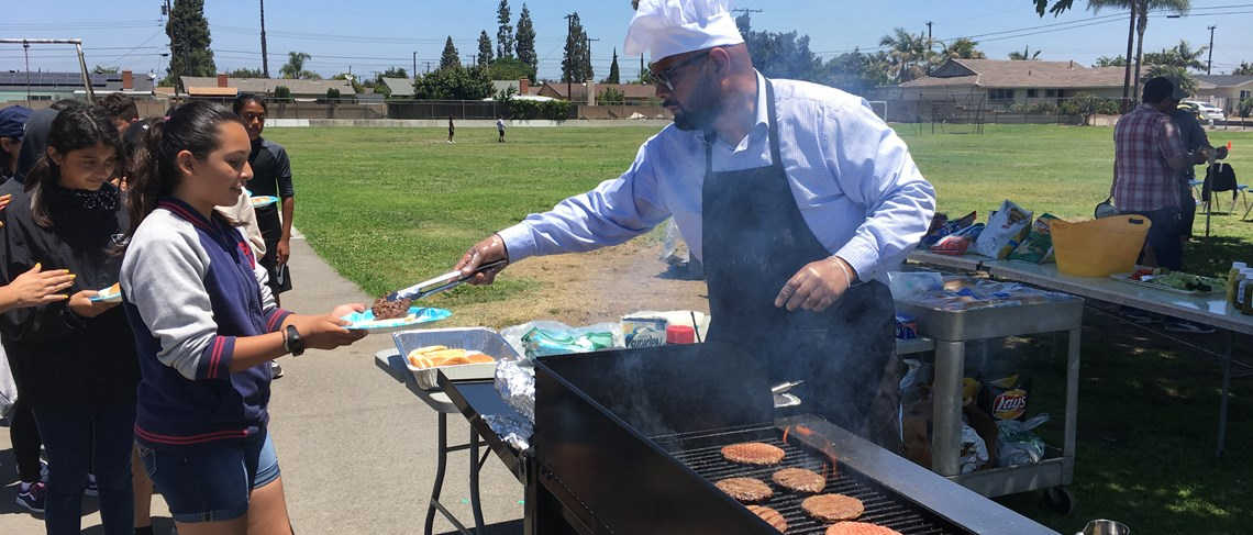 Principal Martinez showed Paine students his culinary side, as he continued his tradition of providing a barbecue lunch for the 6th grade students.