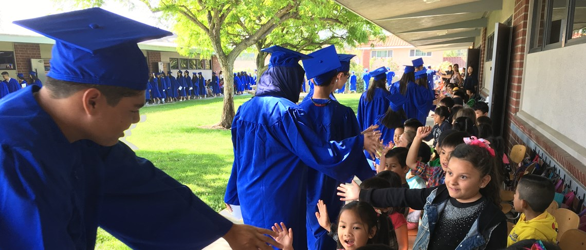Throughout the hallways and across the campus of Thomas Paine Elementary School, La Quinta High School class of 2018 graduates make a positive impact on Paine students